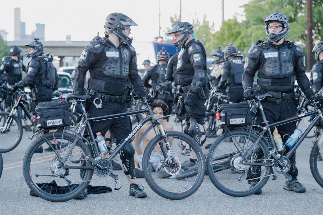 Seattle, WA, USA. Police officers at protest with bikes 2016